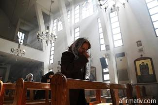 woman-praying-in-a-church-in-middle-east