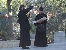 220px-2_priests_checking_merchandise